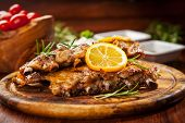 stock photo of spare  - BBQ spare ribs with orange and dips - JPG