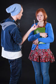 stock photo of politeness  - Teenager boy giving marijuana to polite friend - JPG