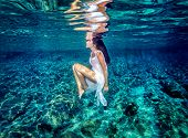 foto of blue  - Beautiful dance underwater - JPG