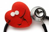 pic of broken heart  - Red broken heart stethoscope and pills on white - JPG
