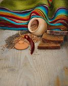 stock photo of cumin  - Still life with bread buckwheat and cumin on a wooden board - JPG