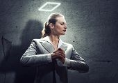 stock photo of halo  - Young saint businesswoman with halo above head - JPG