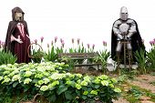 Medieval Scene With A Knight In A Flower Garden poster