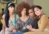 stock photo of bff  - Diverse group of 1960s women sitting together - JPG