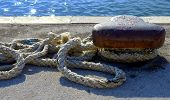pic of bollard  - Thick Rope Securely Tied around Bollard at the Harbor - JPG