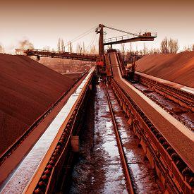 image of iron ore  - loading iron ore conveyor machine from the warehouse mining production - JPG