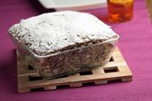 pic of cheesecake  - Cheesecake with poppy seeds topped with powdered sugar - JPG