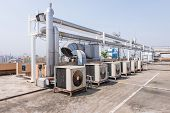foto of air compressor  - Air conditioning compressor on the Rooftop terrace of building - JPG