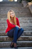 picture of straight jacket  - Young beautiful blonde woman with long straight hair and gray - JPG
