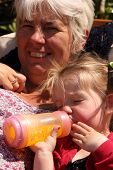 picture of granddaughter  - A grandmother with her granddaughter falling asleep - JPG