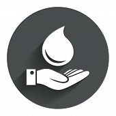 stock photo of save water  - Water drop and hand sign - JPG