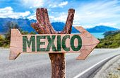 picture of playa del carmen  - Mexico wooden sign with road background - JPG