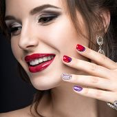 stock photo of nail-design  - Beautiful girl with a bright evening make - JPG