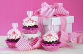 picture of cake stand  - Happy Mothers Day pink and white cupcakes on retro style cake stands and large gift box on vintage white wood table - JPG