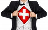 pic of flag confederate  - businessman showing Switzerland flag underneath his shirt over white background - JPG