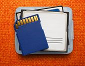 pic of memory stick  - Blue compact memory cards for camera on cloth background - JPG