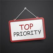 picture of priorities  - top priority hanging sign isolated on black wall - JPG