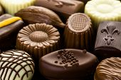 pic of truffle  - Delicious chocolate truffles and candy on a dark background - JPG