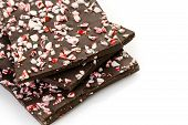 stock photo of peppermint  - Choolate bark with peppermint on a white background - JPG