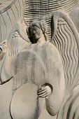 pic of funeral home  - lovely angel in stone with wings spread - JPG