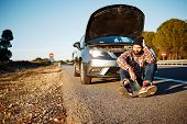 stock photo of sad man  - Car and driver man in beautiful sunny landscape - JPG