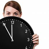 image of analog clock  - Young woman holding clock isolated on a white background - JPG