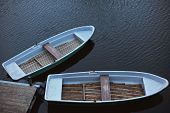 image of jetties  - Two old rowing boats at jetty footbridge  - JPG