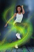picture of step aerobics  - Fit woman doing aerobic exercise against dark grey room - JPG