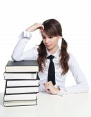 stock photo of teen pony tail  - Sad schoolgirl with sitting with stack of books - JPG