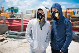 foto of respirator  - Portrait of two young people in respirators standing outdoors - JPG