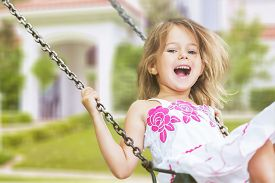 stock photo of swing  - Child Playing Playground Little Girls Swing Laughing Cheerful - JPG