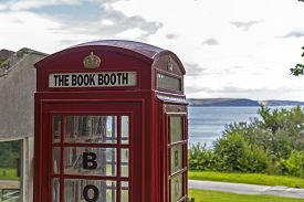 stock photo of phone-booth  - Showing a phone booth converted to a book share - JPG