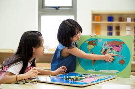 foto of south east asia  - Little asian girl looking South east asia for play jigsaw on a geographical map - JPG