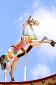stock photo of carousel horse  - Carousel horse with blue sky background - JPG