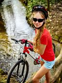 Bicycle teen with ladies bikes in summer park. Womens road bike for running on nature. Girl cycling  poster