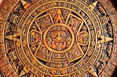 image of cultural artifacts  - A close up view of a aztec calendar - JPG