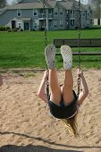 image of pubescent  - a little girl swinging on a swing - JPG