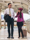 Couple Travellers Walking In Airport Walkway poster