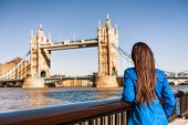 Tower Bridge London city travel woman tourist girl at Europe destination landmark famous attraction. poster