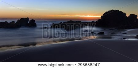 poster of A Long Exposure Sunrise Over The Surf On Flynns Beach At Port Maquarie On The New South Wales Mid Co