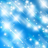 picture of glitter sparkle  - bright glitters on a soft blue background - JPG