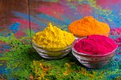 Holi color powder. Organic Gulal colours in bowl for Holi festival, Hindu tradition festive. Bright  poster