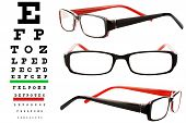 stock photo of snellen chart  - Reading glasses with eye chart extreme closeup - JPG