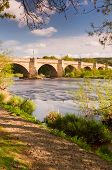 picture of tyne  - Bridge over the river Tyne leading into Corbidge village on a sunny spring day - JPG