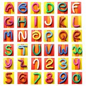 image of molding clay  - Colorful plasticine alphabet isolated over white background - JPG