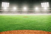 Baseball Field At Brightly Lit Outdoor Stadium. Focus On Foreground And Shallow Depth Of Field On Ba poster
