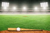 Baseball Bat And Ball On Field At Brightly Lit Outdoor Stadium. Focus On Foreground And Shallow Dept poster