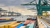 Loaded Ships In Busy Port Of Antwerp At Container Terminal With Automated Cranes And Lots Of Vessels poster