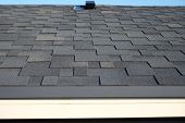 Close Up View On Asphalt Roofing Shingles Background. Roof Shingles - Roofing. Bitumen Tile Roof. poster