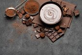 Ceramic Bowl Of Chocolate Cream Or Melted Chocolate And Pieces Of Chocolate Isolated On Dark Concret poster